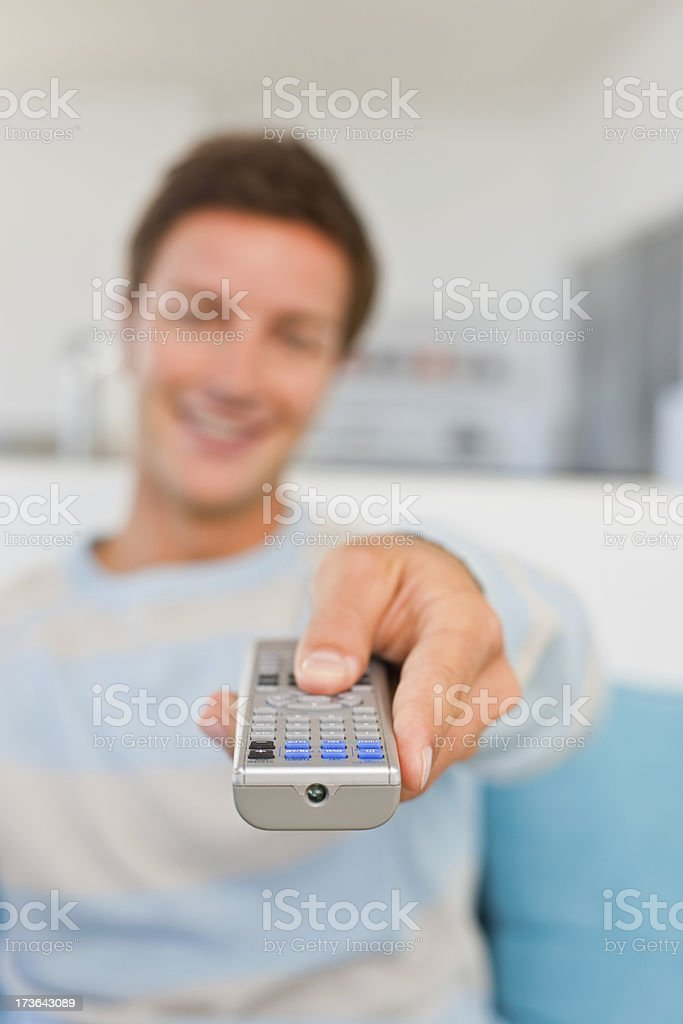 Blurred image of a man holding remote control royalty-free stock photo