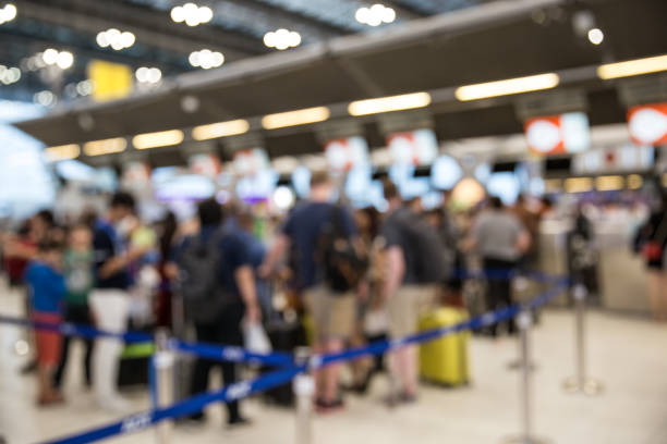 Blurred image of airport check-in counters with passengers and crowded. stock photo