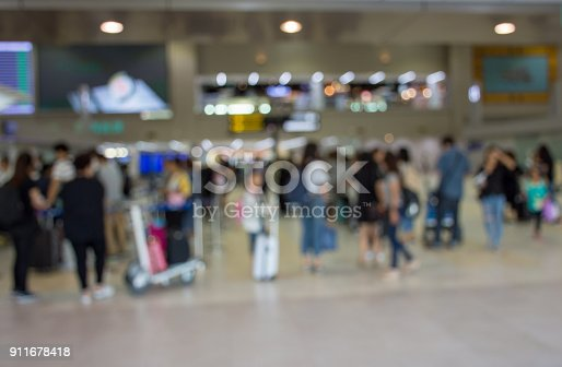 istock Blurred image of airport passengers in airport terminal. 911678418