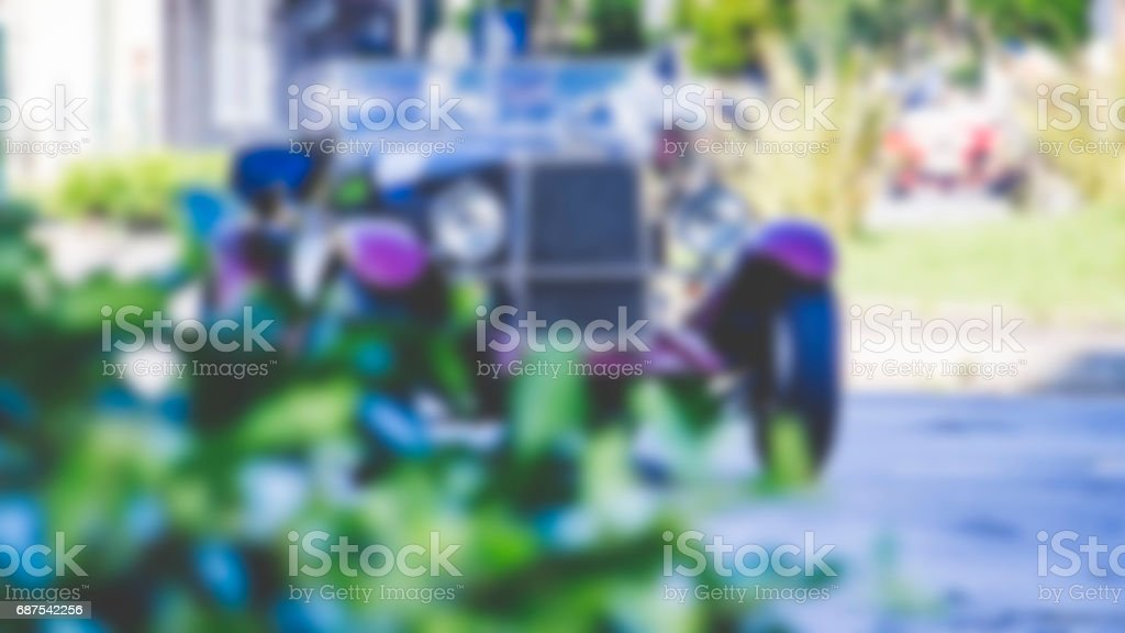 Blurred image of an antique car in daylight riding in the streets stock photo