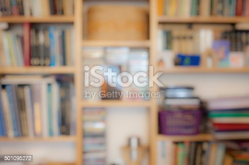 istock Blurred image of bookshelves with books 501095272