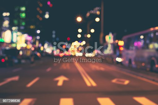 Defocused, blurred urban abstract traffic background. Night city background.