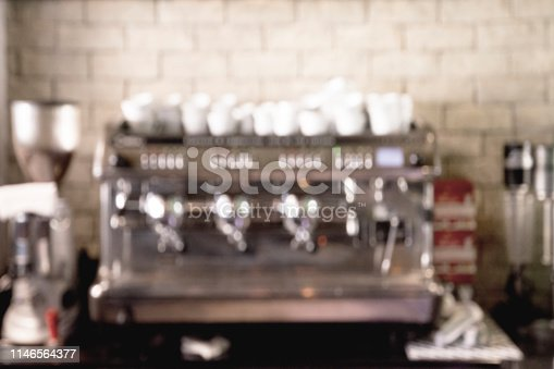 istock Blurred image of Coffee Machine with lot of bokeh in vintage style effect 1146564377