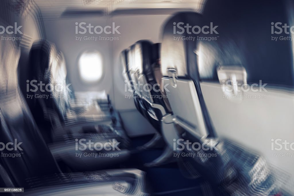 Blurred image of commercial or cargo plane moving fast downwards. stock photo