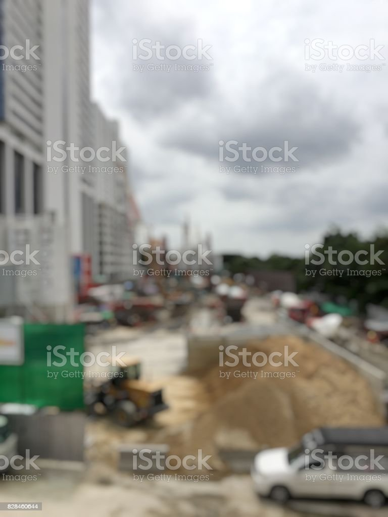 blurred image of construction workers on site and machinery on the street building.  Construction Concept. stock photo