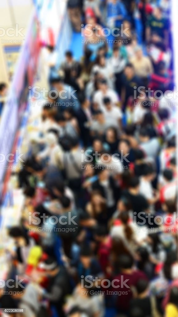 Blurred image of crowd in a trade show.