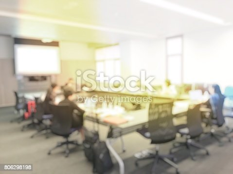 831720990istockphoto Blurred image of education people and business people sitting in conference room for profession seminar and the speaker is presenting new technology and idea sharing with the content activity project. 806298198