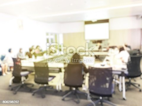 831720990istockphoto Blurred image of education people and business people sitting in conference room for profession seminar and the speaker is presenting new technology and idea sharing with the content activity project. 806298252