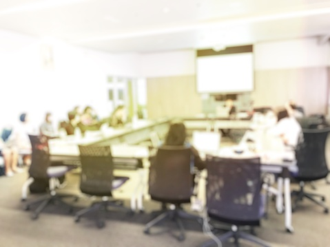 831720990 istock photo Blurred image of education people and business people sitting in conference room for profession seminar and the speaker is presenting new technology and idea sharing with the content activity project. 806298252