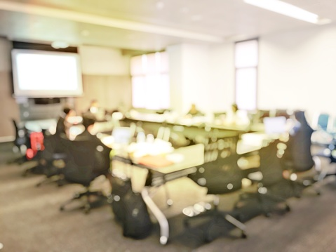 831720990 istock photo Blurred image of education people and business people sitting in conference room for profession seminar and the speaker is presenting new technology and idea sharing with the content activity project. 806298310