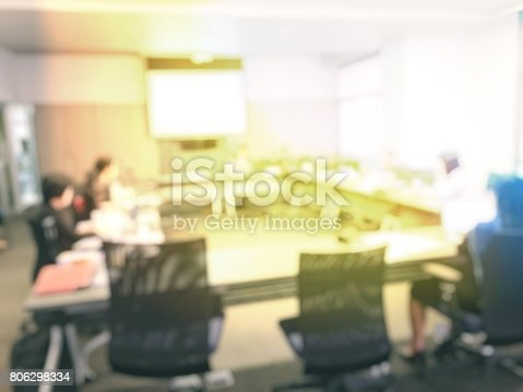 831720990istockphoto Blurred image of education people and business people sitting in conference room for profession seminar and the speaker is presenting new technology and idea sharing with the content activity project. 806298334