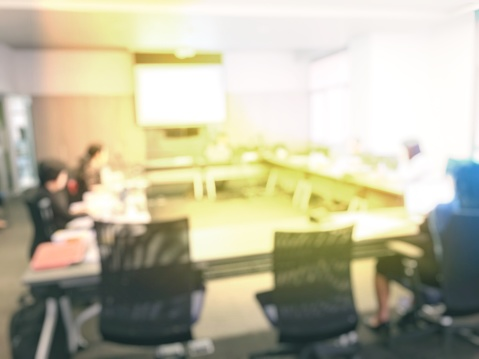 831720990 istock photo Blurred image of education people and business people sitting in conference room for profession seminar and the speaker is presenting new technology and idea sharing with the content activity project. 806298334