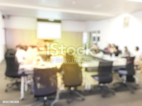 831720990istockphoto Blurred image of education people and business people sitting in conference room for profession seminar and the speaker is presenting new technology and idea sharing with the content activity project. 806298368
