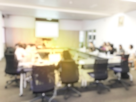 831720990 istock photo Blurred image of education people and business people sitting in conference room for profession seminar and the speaker is presenting new technology and idea sharing with the content activity project. 806298368