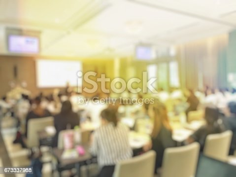 istock Blurred image of education people  sitting in conference room 673337988