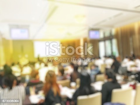 istock Blurred image of education people  sitting in conference room 673338064