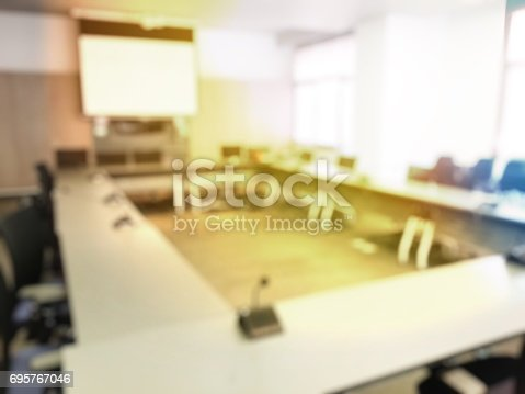 831720990istockphoto Blurred image of education people sitting in meeting room for profession seminar or education media discussion for present the new project. 695767046