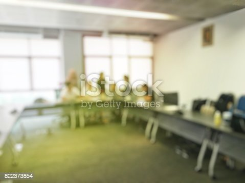 831720990istockphoto Blurred image of education people sitting in meeting room for profession seminar or education media discussion for present the new project. 822373854
