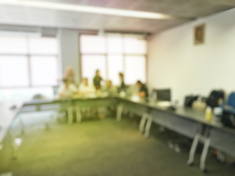 831720990 istock photo Blurred image of education people sitting in meeting room for profession seminar or education media discussion for present the new project. 822373854