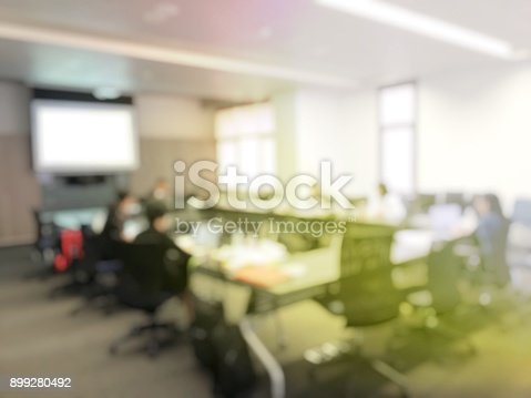 istock Blurred image  of employees young colleagues and business team sitting at the meeting room or seminar room, congress tele meeting video call with projector screen in office. vintage effect 899280492