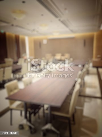 879125330 istock photo Blurred image of empty interior of conference room, meeting room prepare for webinar. Blurry nobody in Classroom, Office with chairs and tables. vintage tone. Abstract blur for background usage. 859076642