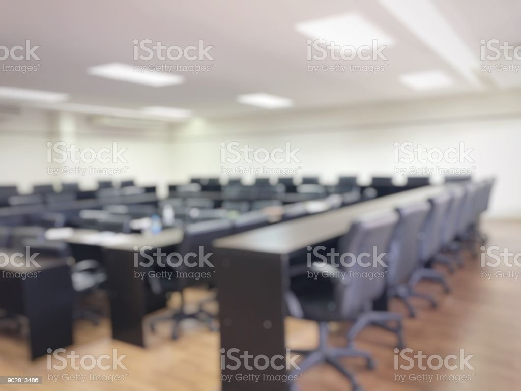 Blurred image of empty meeting room, conference room, Board room with...