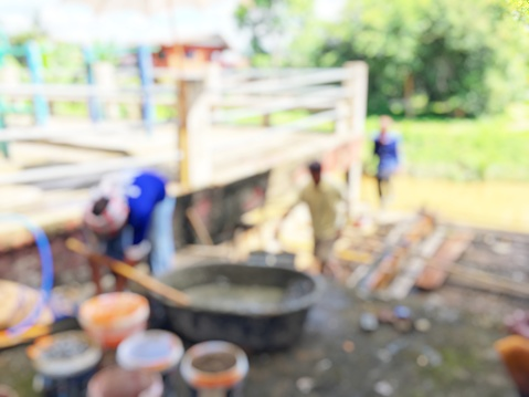 Blurred Image Of Group Asian Laborers Working In The Construction Site For Road Street Repairing And Resurfacing Works Fresh Asphalt Construction Stock Photo & More Pictures of Activity