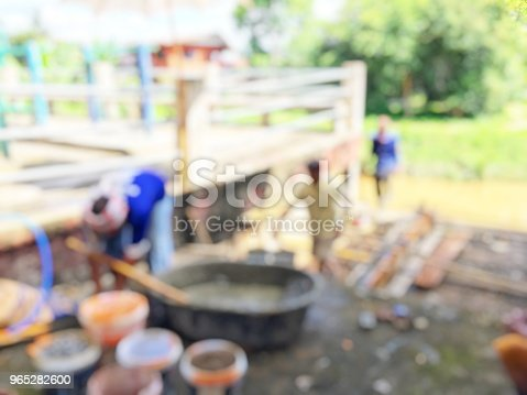 Blurred Image Of Group Asian Laborers Working In The Construction Site For Road Street Repairing And Resurfacing Works Fresh Asphalt Construction - Stockowe zdjęcia i więcej obrazów Bieżnia