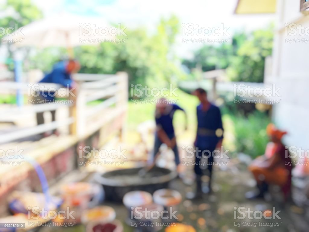 blurred image of group asian laborers working in the construction site for road street repairing and resurfacing works. Fresh asphalt construction. zbiór zdjęć royalty-free