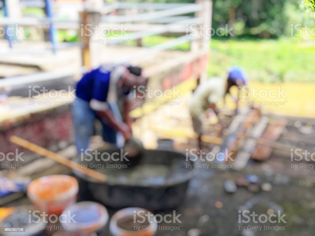 blurred image of group asian laborers working in the construction site for road street repairing and resurfacing works. Fresh asphalt construction. royalty-free stock photo