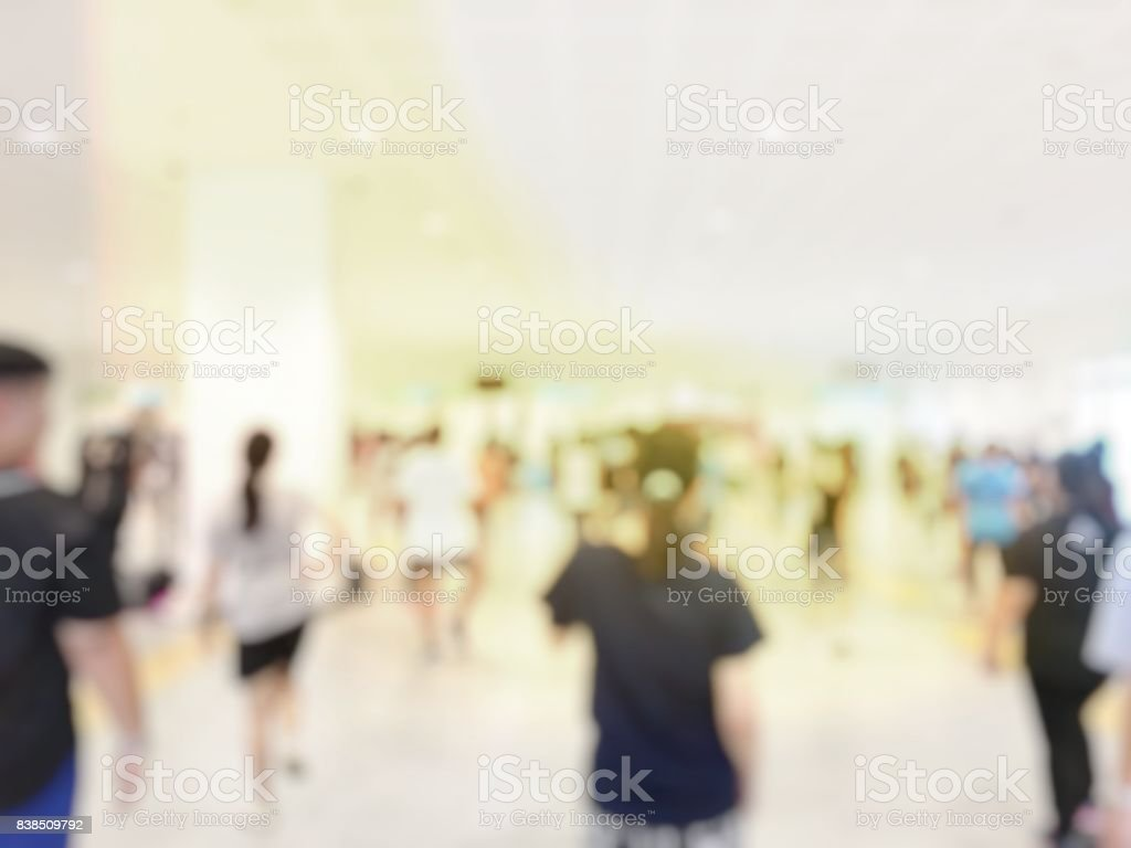 blurred image of group people training in the gym with weights. concept about training  workout and aerobic, interior of new modern fitness center gym with equipment, Abstract blur gym background stock photo