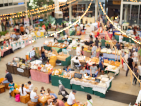 Blurred image of people in market of food festival background top view.