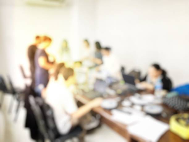 blurred image of people meeting and working final business project stock photo