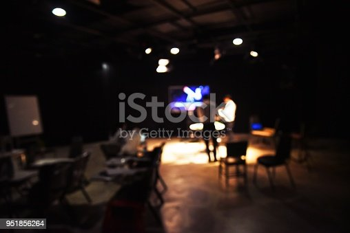istock blurred image of people production team shooting some movie or setting education content for production for tv commercial in the culinary studio with studio equipment and video light stands and crew. 951856264