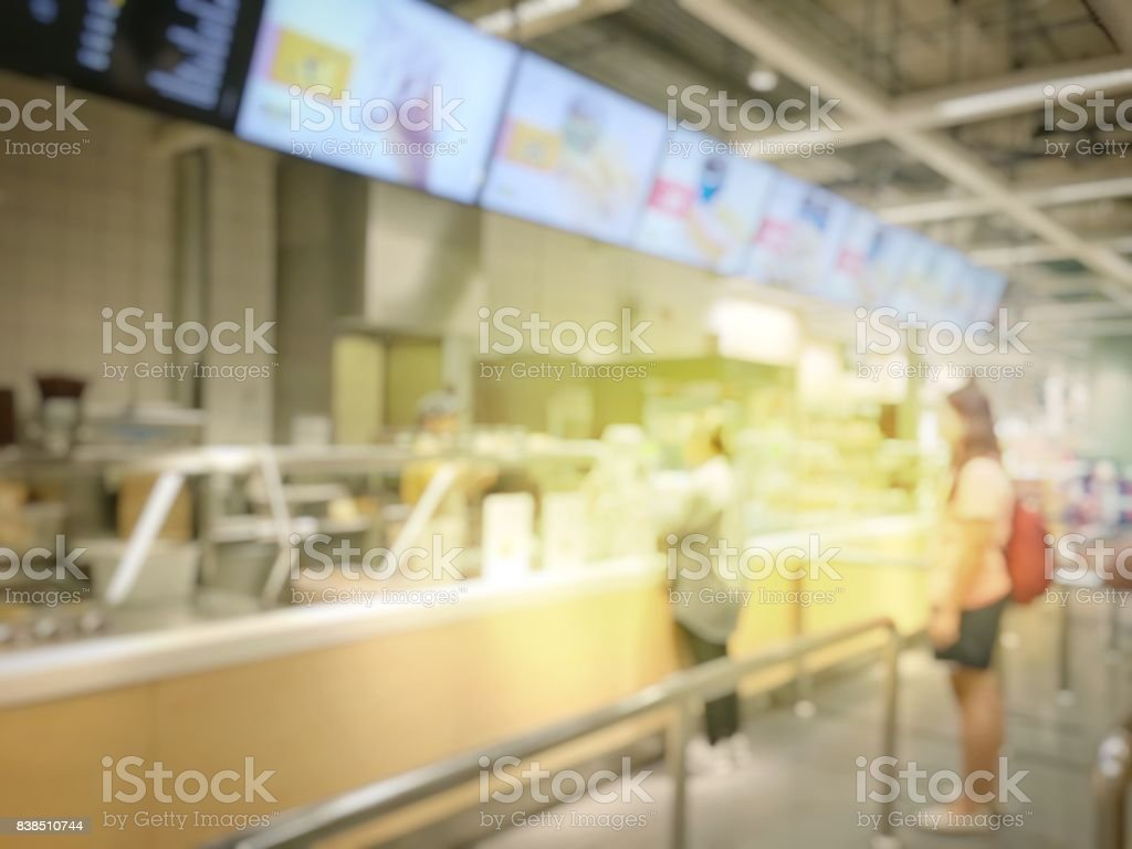 5a5b9911b2 Blurred image of people queue up waiting in line to buy fast food in  Fastfood Store or Seflservice Restaurant. - Stock image .