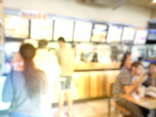 blurred image of People Wait to Order food and make Payment in Fastfood Store. stock photo
