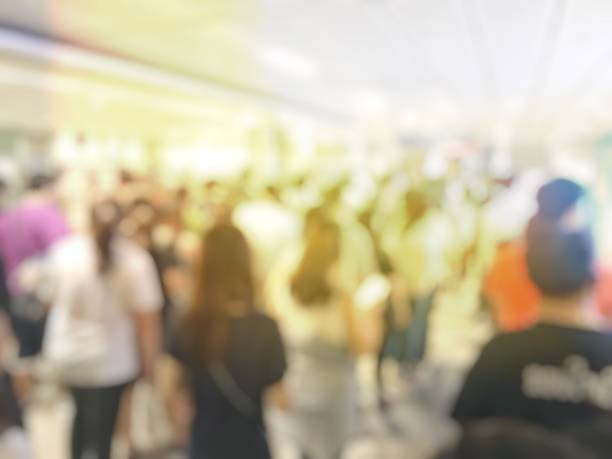 blurred image of people walking to exit from public subway during rush hour, Stay in the crowd cause stress in everyday life. stock photo