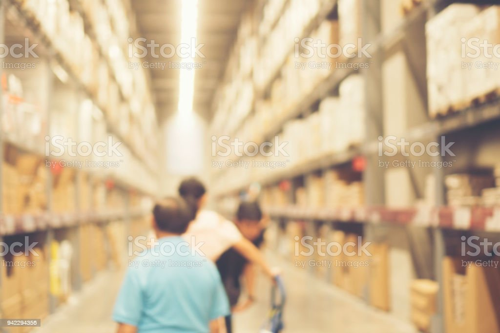 Blurred image of shelf in modern distribution warehouse or...