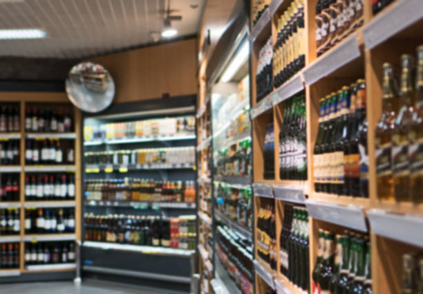 Blurred image of shelves with alcoholic drinks in supermarket. stock photo