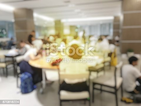 istock blurred image of teamwork people concept.Young team of coworkers making great business discussion in modern coworking office and talking with partners while showing new startup idea monitor 870818224