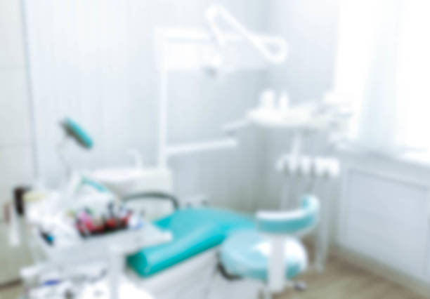 blurred image of the dentist office, medical background. dentist cabinet. - dentists office stock pictures, royalty-free photos & images