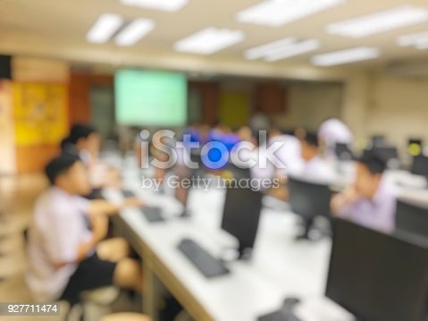 814301186 istock photo blurred image of the student learning technology and workshop using computer together in computer room in secondary, university for study, Network communication, education or training concept. 927711474