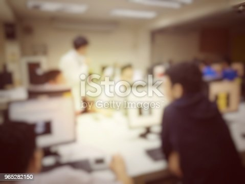 814301186 istock photo blurred image of the student learning technology and workshop using computer together in computer room in secondary, university for study, Network communication, education or training concept. 965282150