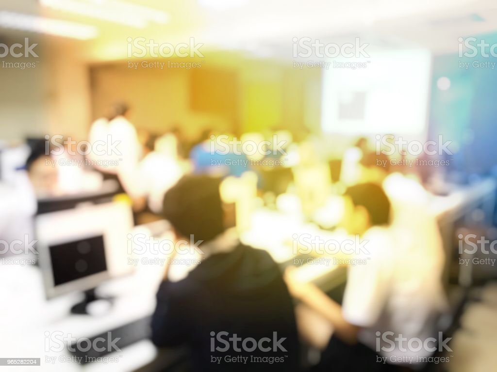 blurred image of the student learning technology and workshop using computer together in computer room in secondary, university for study, Network communication, education or training concept. royalty-free stock photo