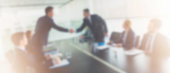 istock Blurred image of two businessmen shaking hands 635949862