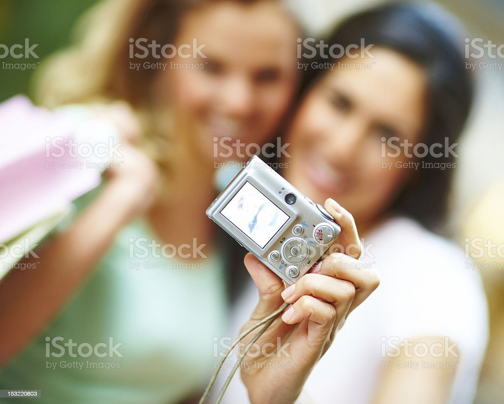 Blurred image of two young women taking self photograph royalty-free stock photo