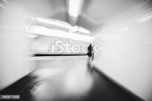 Monochrome abstract view of a subway station corridor with blurred motion in Paris metro, France