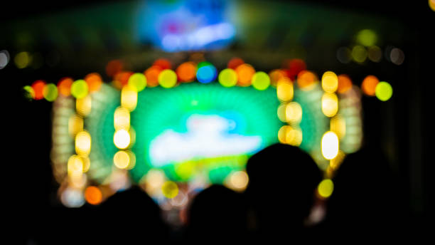 blurred images of the concert stage full of bokeh lights at night. - theatre full of people stage foto e immagini stock
