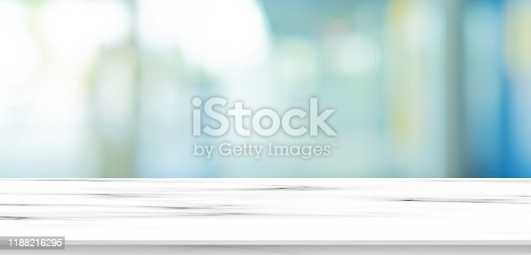 blurred inside of interior luxury modern bathroom in the morning panoramic background with white marble pattern tabletop for show, promote ads and design product on display concept