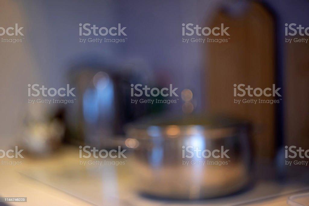 A blurred kitchen background. Blur image of modern Kitchen Room...